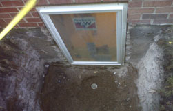 Egress Window Exterior Well Installation in Process